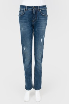 Синие джинсы с потертостями