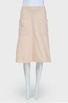 Расклешенная юбка с накладными карманами