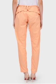 Персиковые брюки со шнуровкой