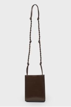 Кожаная сумка на плетеном ремне