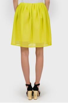 Желтая юбка с цветочной аппликацией