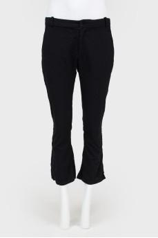 Укороченные расклешенные брюки