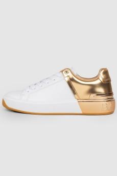 Кроссовки с золотистой пяткой