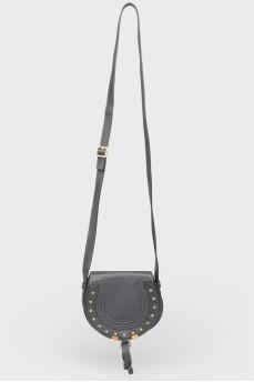 Темно-синяя кожаная сумочка округлой формы