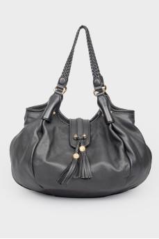 Черная кожаная сумка с плетеными ручками
