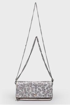 Серебристая сумка-клатч со стразами