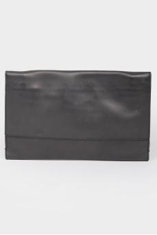 Черный кожаный клатч на кнопке