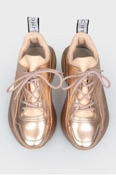 Кроссовки золотистые на платформе