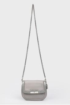 Серая сумочка с лакированными вставками